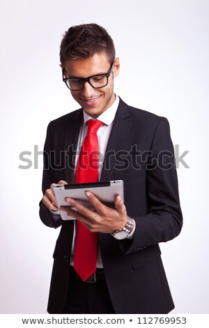 business man browsing on his new tablet pad stock photo © feedough