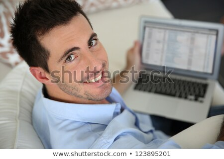 portrait of handsome dark-haired man working on laptop Stock photo © photography33