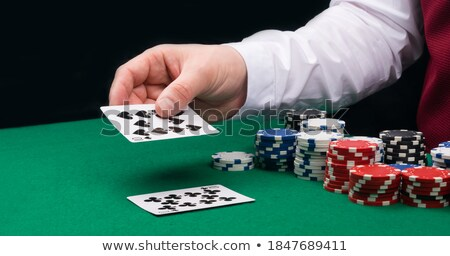 Close up of colourful poker coins against a white background Stock photo © wavebreak_media