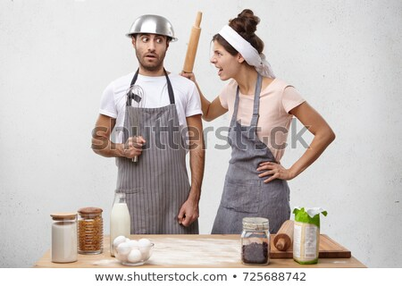 Woman in chef clothing holding rolling pin  stock photo © wavebreak_media