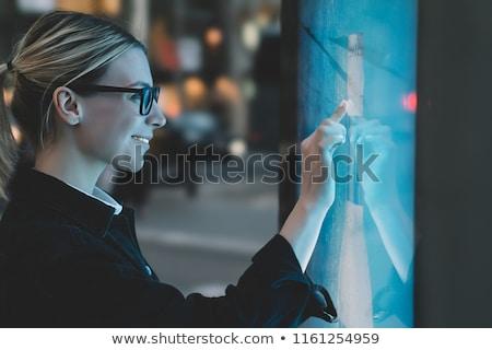 Uśmiechnięta kobieta dotknąć ekranu fioletowy tle nastolatek Zdjęcia stock © wavebreak_media