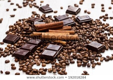 Kaneel chocolade koffiebonen houten kom ondiep Stockfoto © raphotos