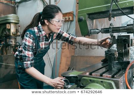 Beautiful Woman With Heavy Drill Stock photo © PetrMalyshev