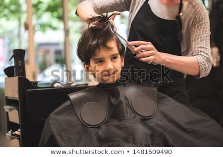 smiling young boy with red hair at the hairdresser Stock photo © meinzahn