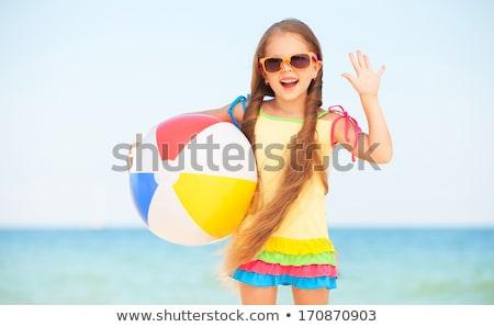 feliz · nina · jugando · inflable · pelota · playa - foto stock © mikko