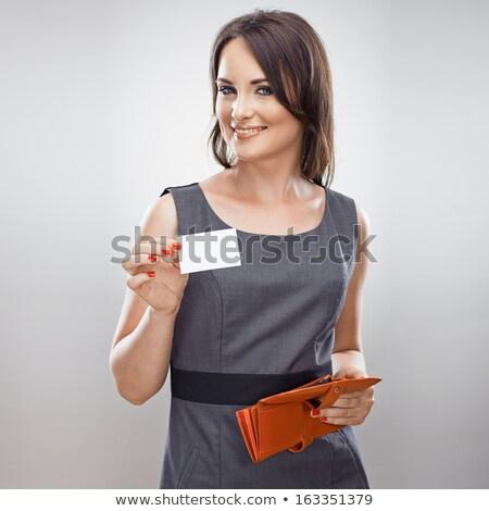 smiling woman with blank plastic card Stock photo © dolgachov