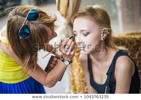 Cute make-up artist holding her vast palette of colors stock photo © lightpoet