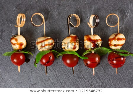 skewer tomatoes on a slate with salad stock photo © philipimage
