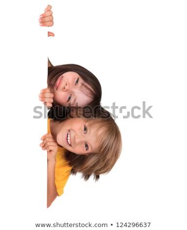 Cute chłopca patrząc około rogu biały Zdjęcia stock © wavebreak_media