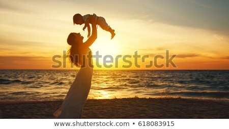 Mother with baby on sunset at sea stock photo © Paha_L