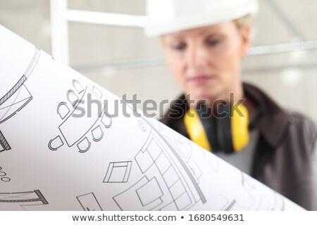 woman wearing hard hat and headphones stock photo © rastudio