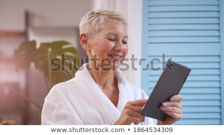 Vrouw grijs badjas permanente venster mooie Stockfoto © deandrobot
