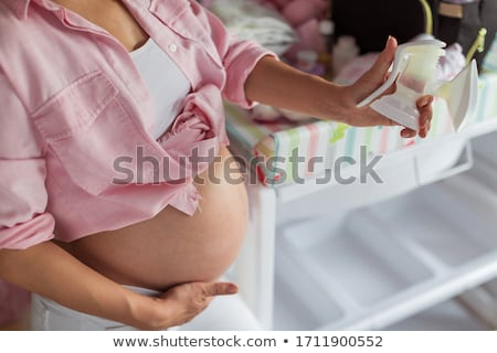 mother with baby and breast pump stock photo © rastudio