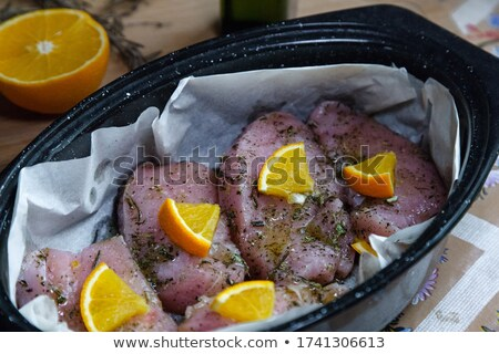 raw duck with orange slices and herbs on tray stock photo © digifoodstock