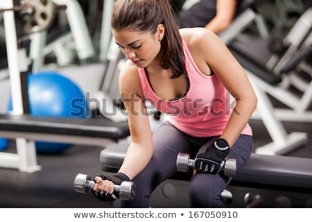 Cute brunette working out at a gym stock photo © Yatsenko