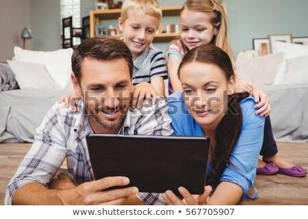 девушки цифровой таблетка диван гостиной Сток-фото © wavebreak_media