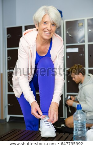 senior female in changing room at gym Stock photo © IS2