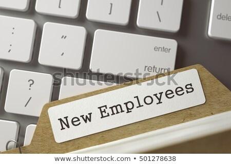 Card Index with New Employees. 3D. Stock photo © tashatuvango