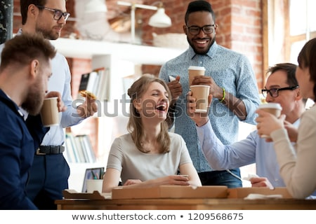 cheerful excited young business man drinking coffee talking by phone stock photo © deandrobot