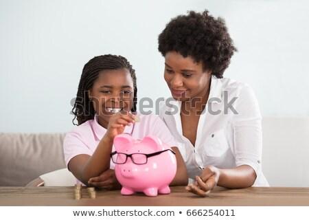 африканских женщину сидят банка безопасной смартфон Сток-фото © studioworkstock