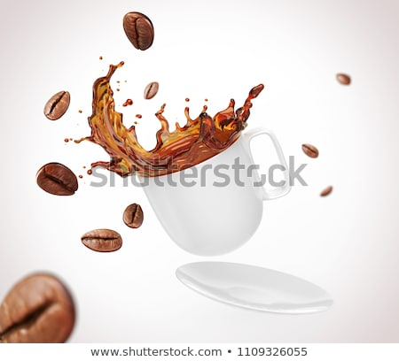 aromatic coffee beans in the form of a pouring drink from italian metal coffee maker on a gray backg stock photo © artjazz