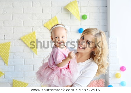 baby girl with parents at home birthday party Stock photo © dolgachov