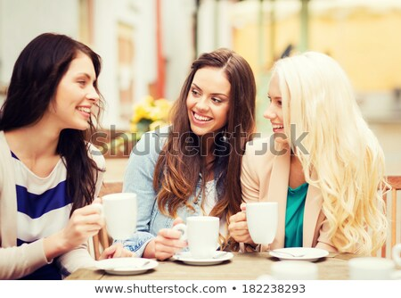 beautiful woman having a cup of coffee outdoor stock photo © minervastock