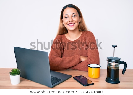 Happy brunette posing with coffee and smiling at camera. Stock photo © studiolucky