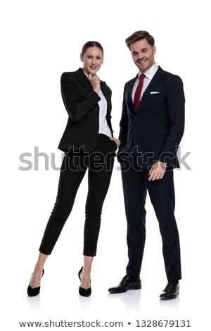 Pareja negocios trajes tomados de las manos barbilla pensando Foto stock © feedough