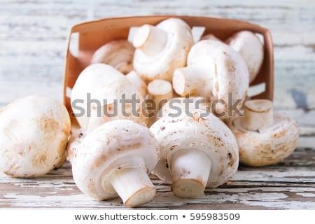 Champignon mushrooms on the wooden board Stock photo © Alex9500