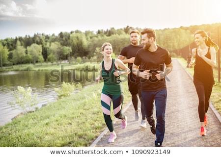 Jogging by waterside Stock photo © pressmaster