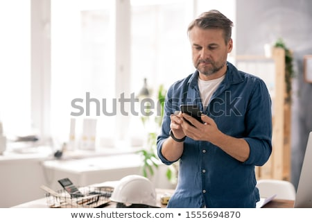 looking through new messages stock photo © pressmaster