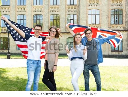 Grup gülen arkadaşlar İngiliz bayrağı vatandaşlık dostluk Stok fotoğraf © dolgachov