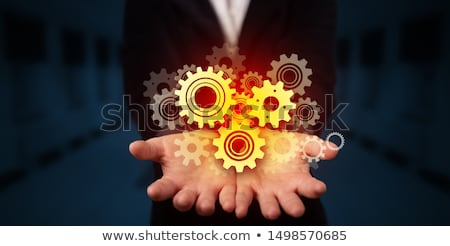 Versnellingen hand man technologie industrie Stockfoto © ra2studio