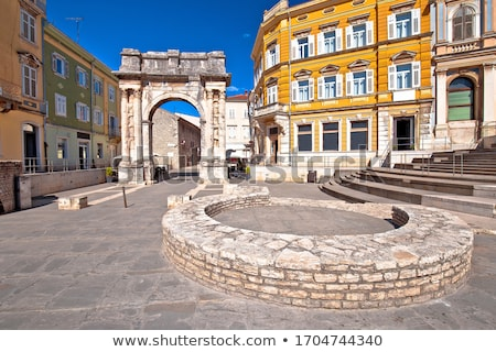 Square in Pula with historic Roman Golden gate street view Stock photo © xbrchx