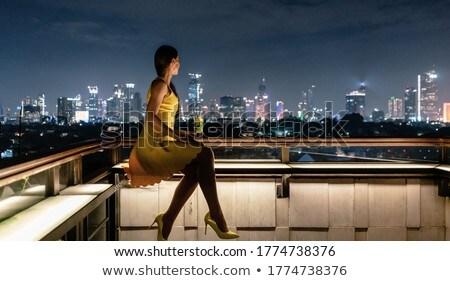 Nő ital tető terasz város városkép Stock fotó © Kzenon