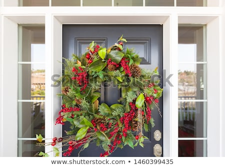 traditional xmas wreath on front door stock photo © backyardproductions