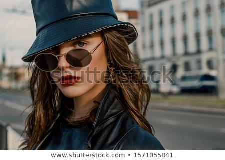 beauty in winter hat and eyeglasses Stock photo © dolgachov