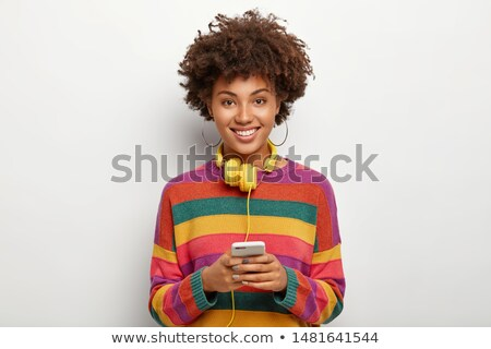 Smiling african teenager in casuals Stock photo © stockyimages