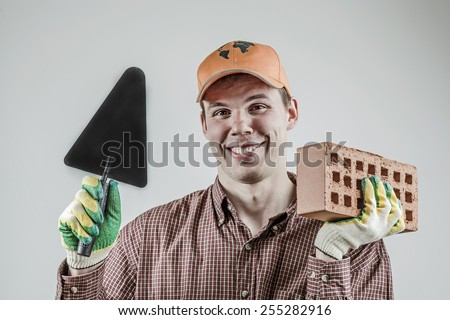 young mason holding a trowel Stock photo © photography33