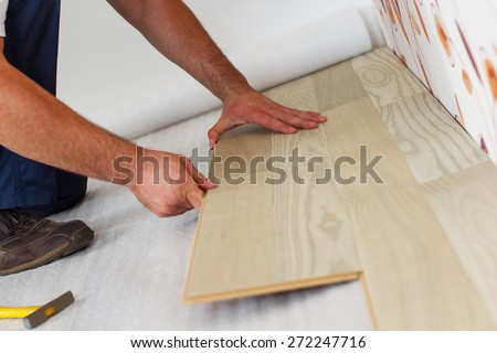 man measuring plank of laminate flooring stock photo © photography33