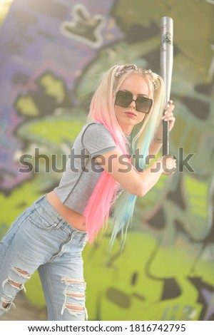 portrait of pretty blonde with a bat stock photo © acidgrey