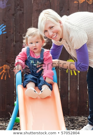 Caucasian girl and her mother having fun with a chute at the playground  Stock photo © wavebreak_media