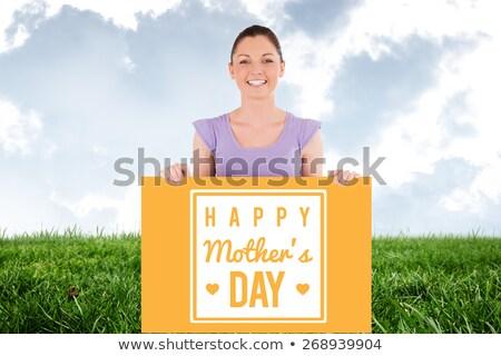 Portret charmant vrouw poseren achter billboard Stockfoto © wavebreak_media