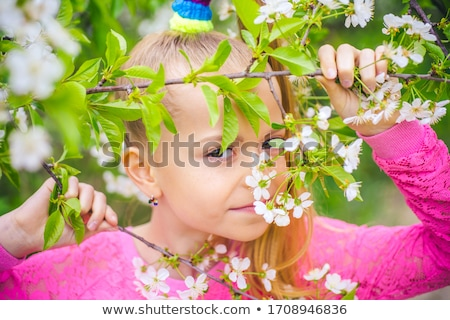 Portrait of beautiful little girl in spring blossom  Stock photo © Andersonrise