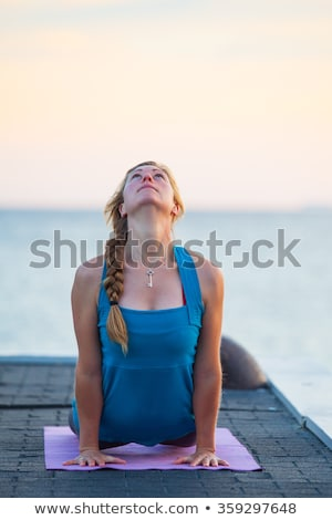 silhouette of a woman practicing yoga at a pier georgian bay t stock photo © bmonteny