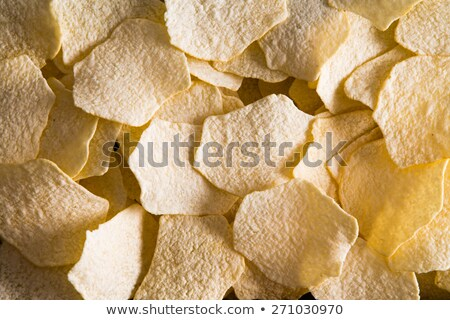 Background texture of oven baked potato chips Stock photo © ozgur