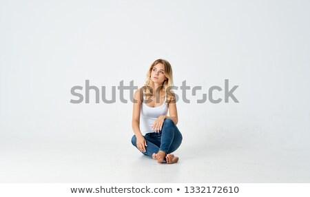 красивая женщина камеры ноутбука сидят полу Сток-фото © wavebreak_media