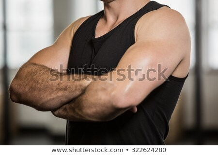 Mid section of a muscular man with arms crossed Stock photo © wavebreak_media
