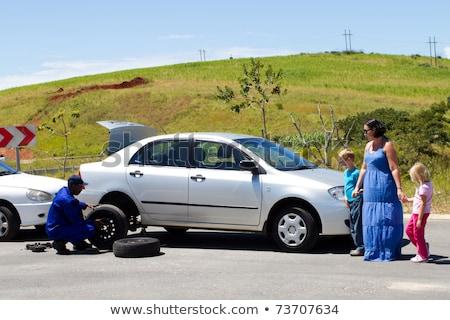 woman tyre change car break down remote road stock photo © roboriginal